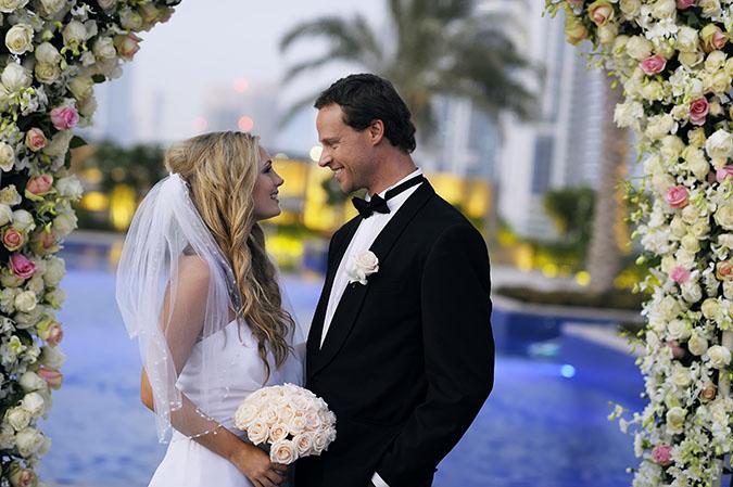 JWMM_Weddings_International_Couple_FlowerArch (2)