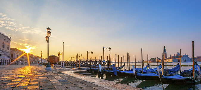 Panoramic view of Venice with gondolas at sunrise