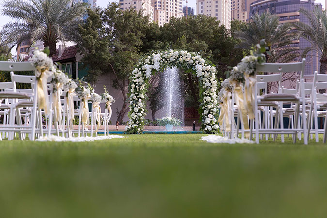 Nigerian destination wedding Dubai flower arch