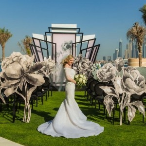 Woman Getting Married on the lawn at the W Hotel Dubai Palm Jumeirah
