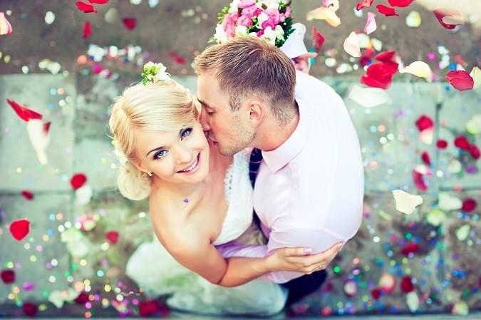 Beautiful wedding couple , groom kisses the bride