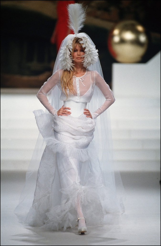 Claudia Schiffer wearing a wedding dress at the Chanel Couture Spring-Summer 1994 show