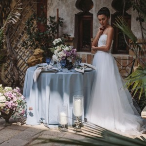 Woman in Dress with Table Setting by Opulent Vision
