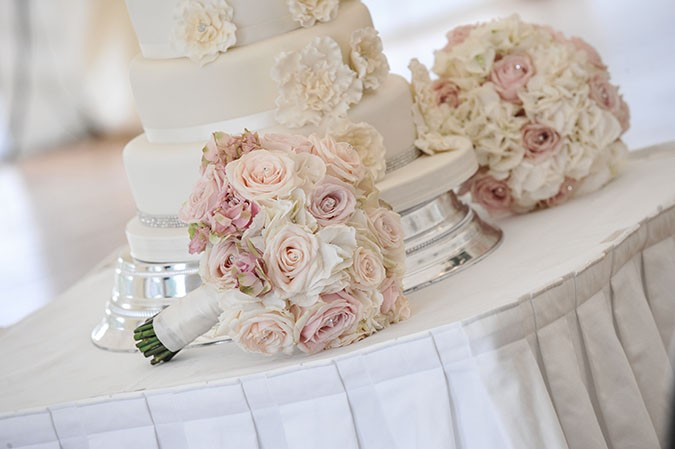 remarkable wedding planners dubai - bouquet and cake table