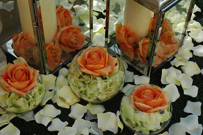 remarkable wedding planners dubai - candles and flowers outdoor set up