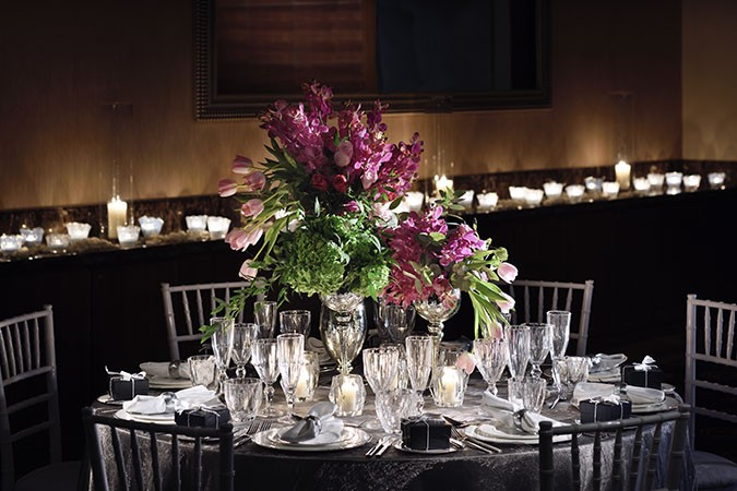 remarkable wedding planners dubai - silver and purple table set up
