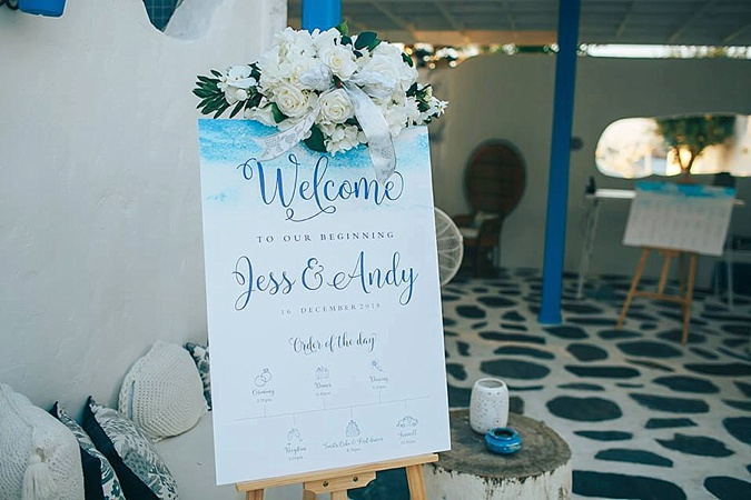 Welcome board at wedding.