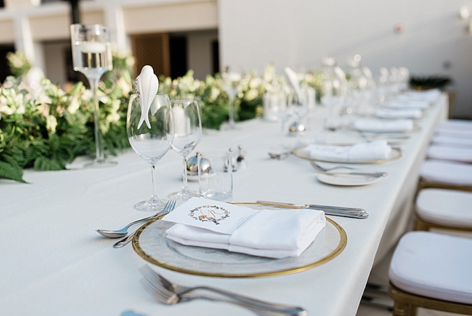 White and gold wedding table setting.