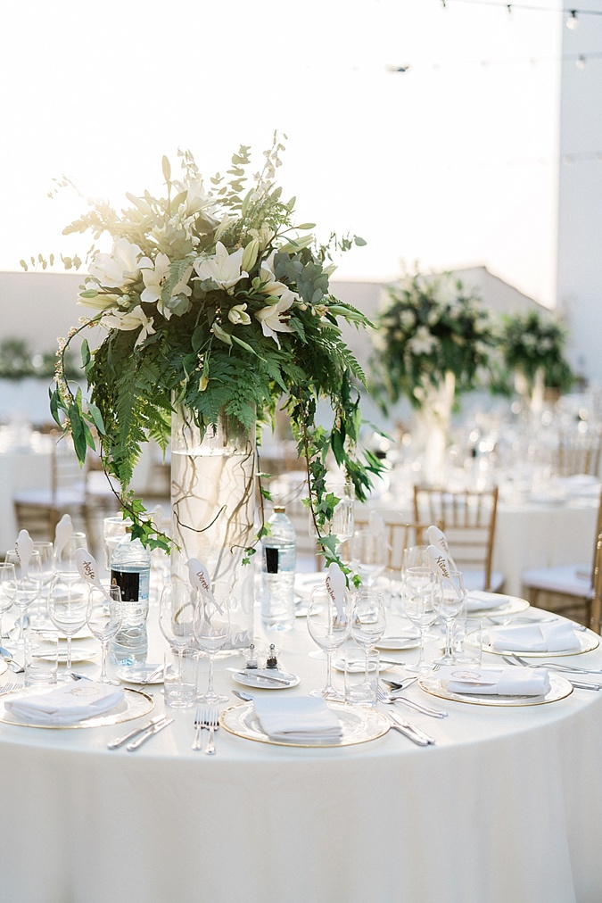 White flowers on wedding table set up.