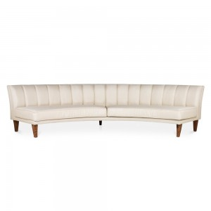 Creme coloured curved long sofa Specstyles furniture rentals in Dubai