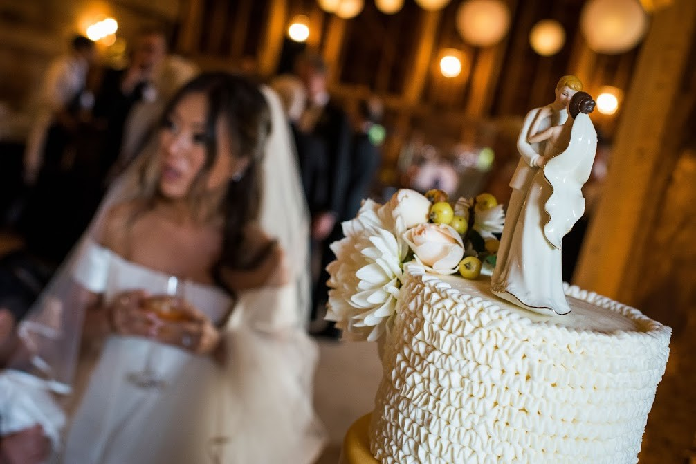 Wedding cake with bride in background