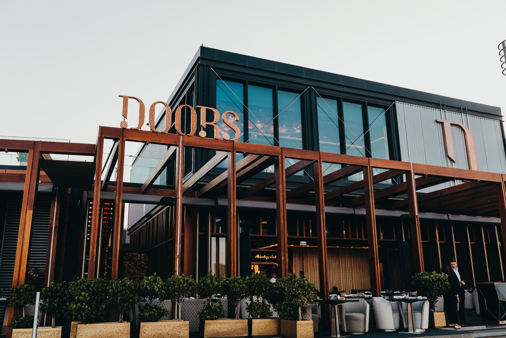 Front entrance of Doors Freestyle Grill nestled against Dubai Creek