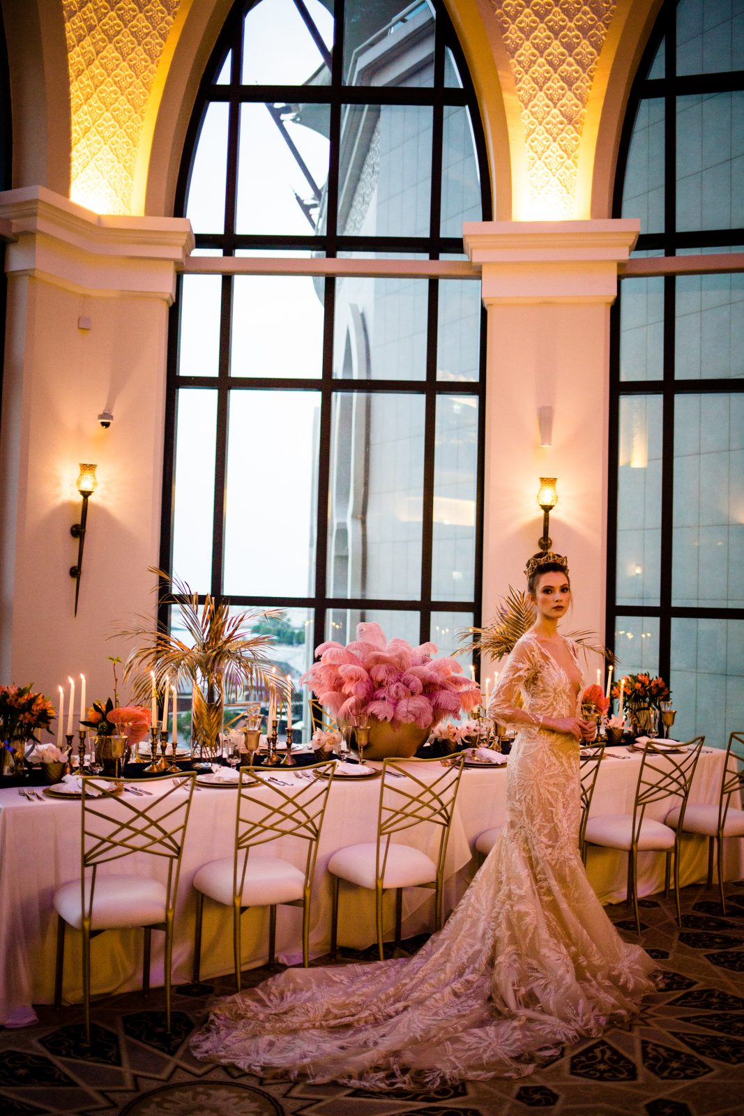 Bride posing by top table set up