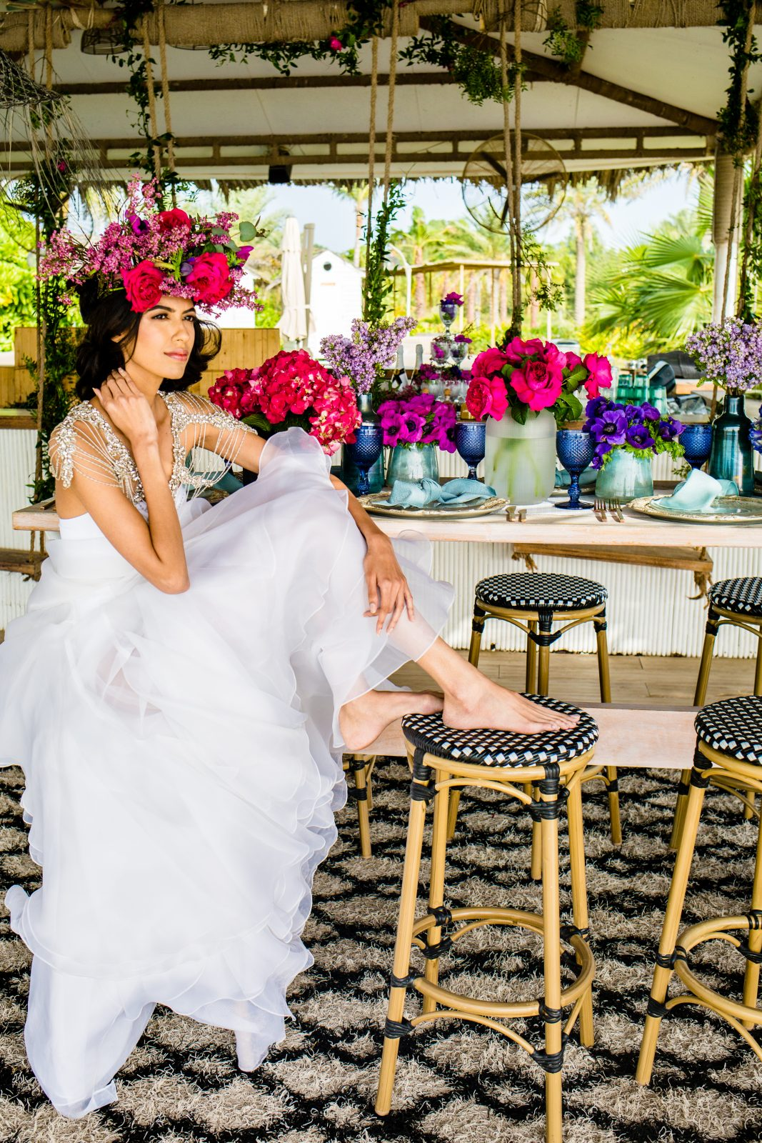 Model posing at beautiful wedding inspired table set up