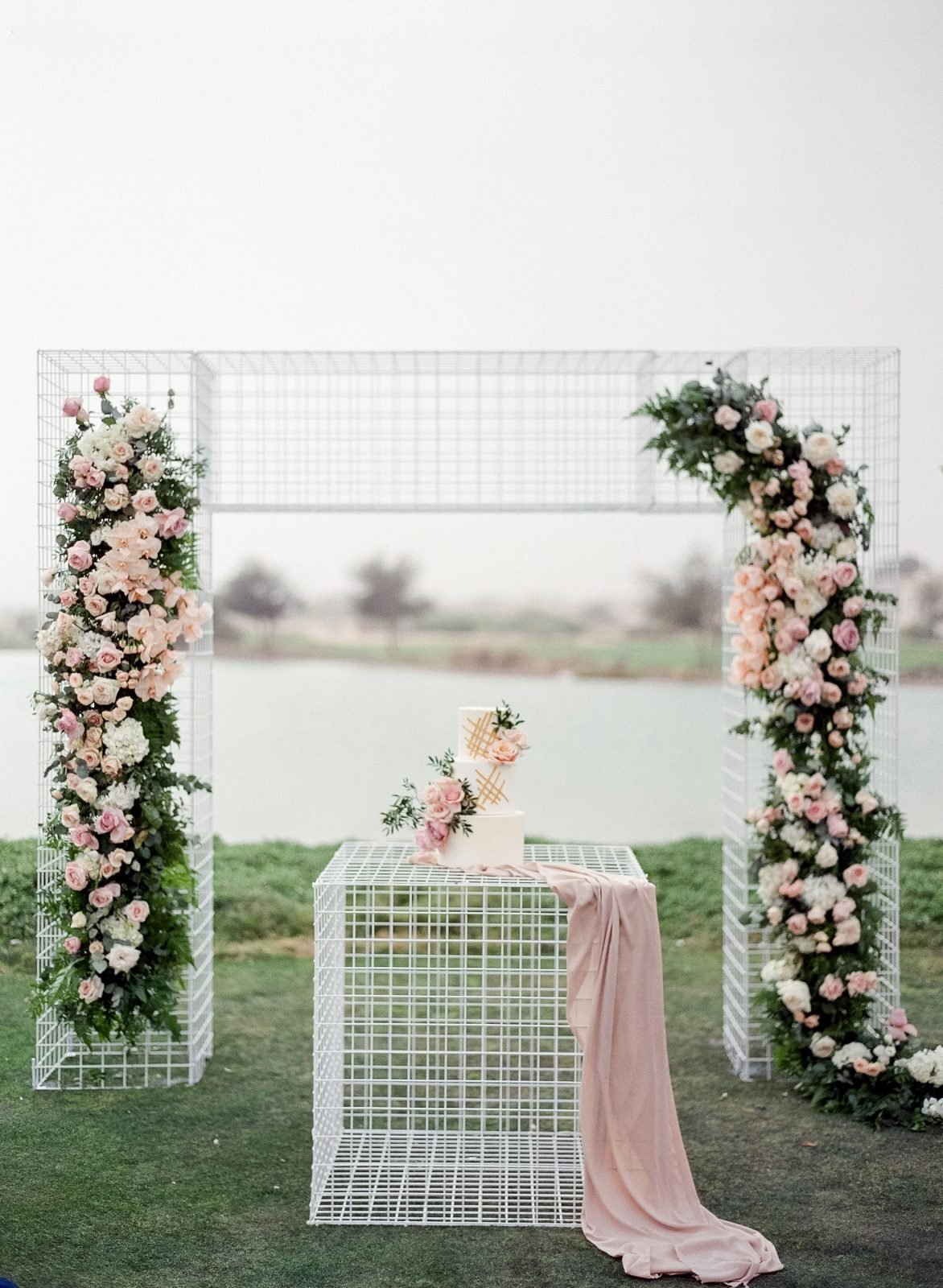 Wire and blush & green florals blessing arch set up