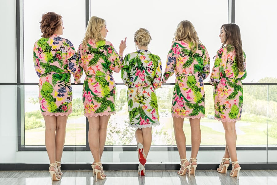 Bridal party in matching tropical dressing gowns