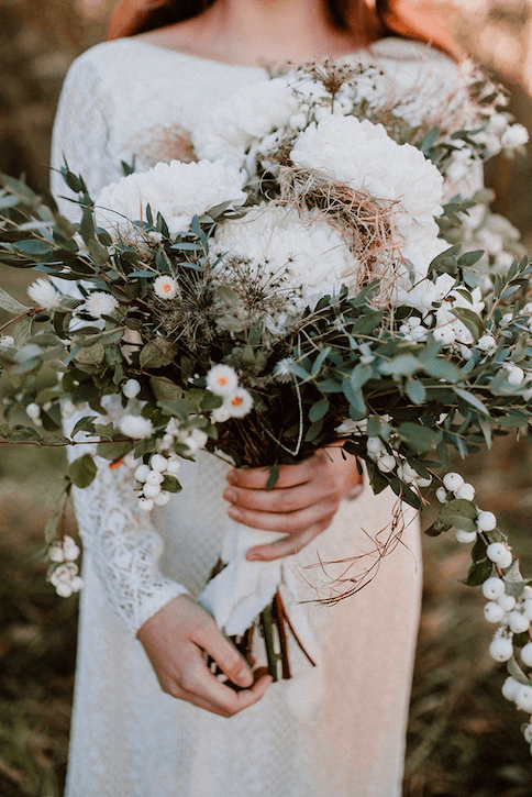 Autumnal wedding bouquet with greenery and daisies