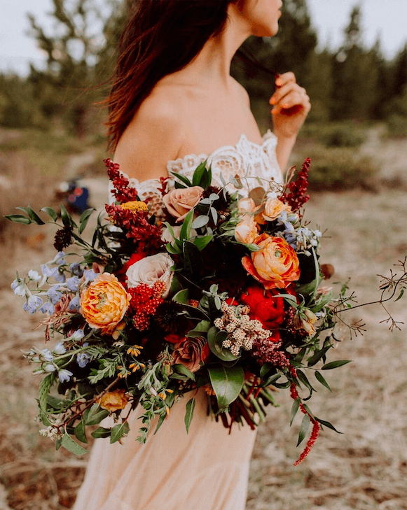 Autumnal wedding bouquet with orange flowers