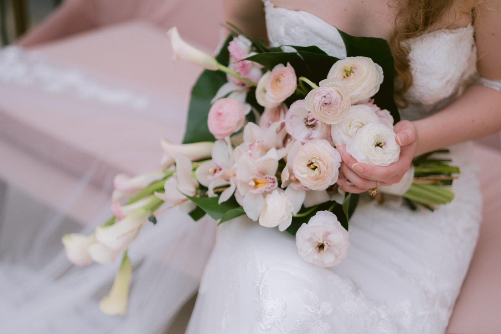 Bride holding light pink and blush bouquet