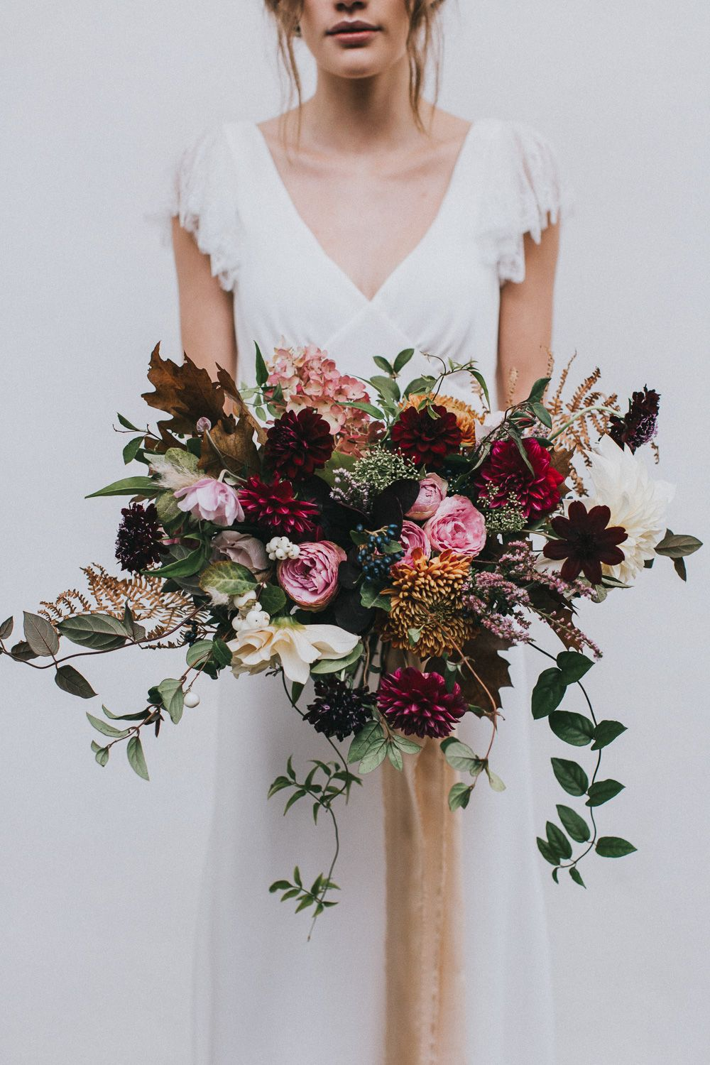 Autumnal wedding bouquet with jewel tones