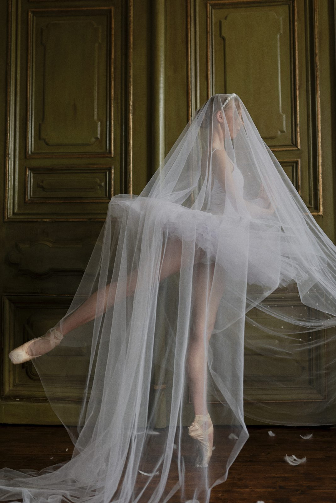 Swan Lake inspired bride with dramatic veil