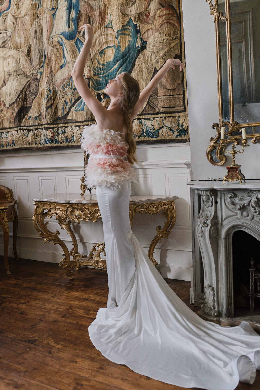 Swan Lake inspired bride in feather gown
