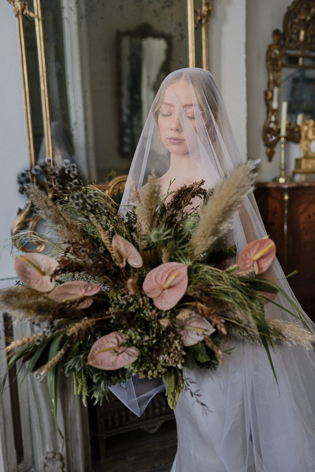 Swan Lake inspired bride with pearl veil and statement bouquet