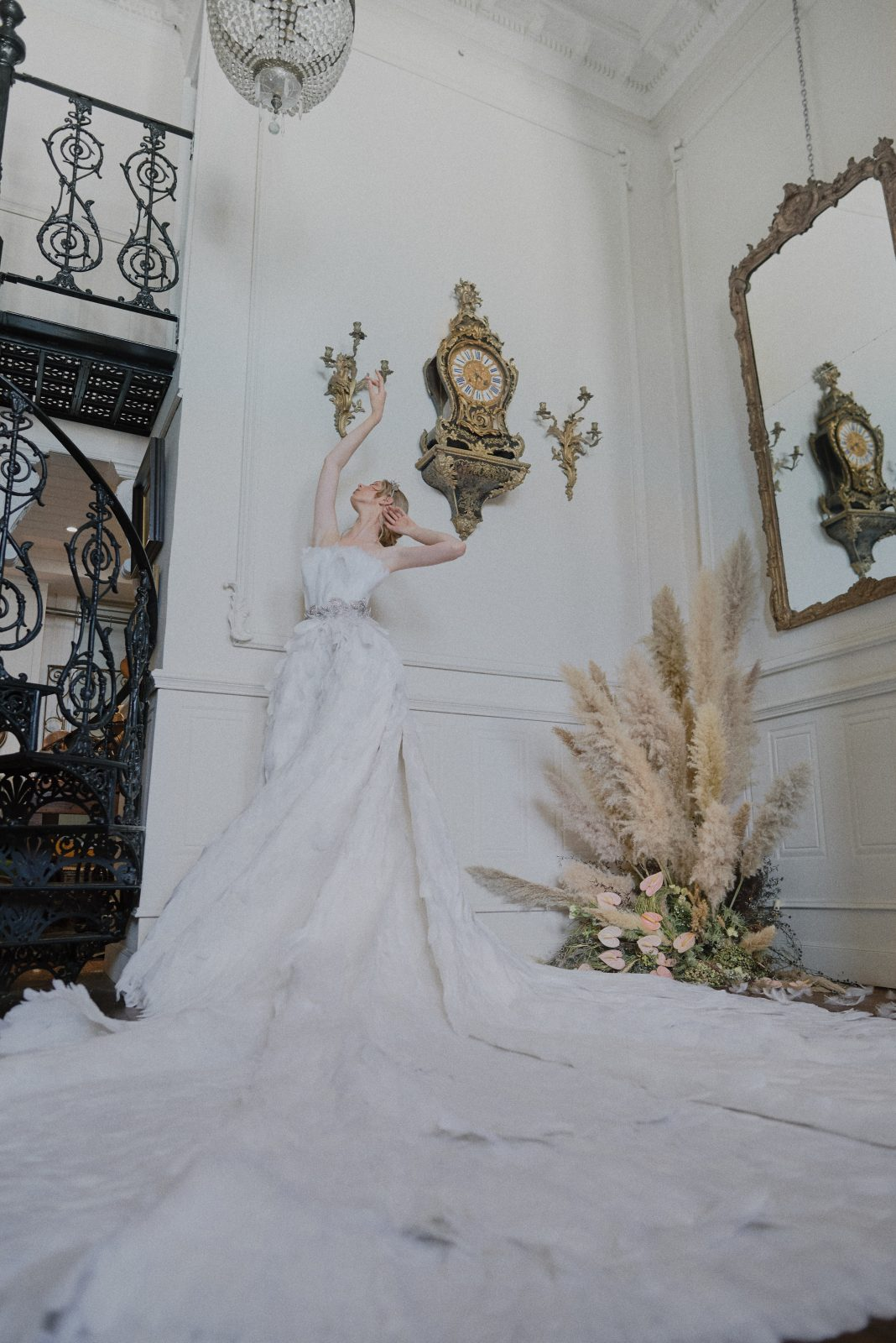 Swan Lake inspired bride with dramatic white feather gown