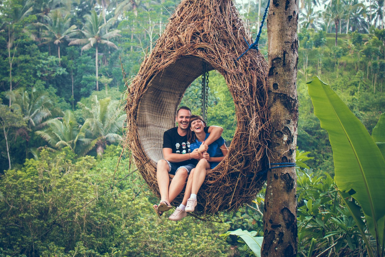 Couple on famous Ubud swing in Bali