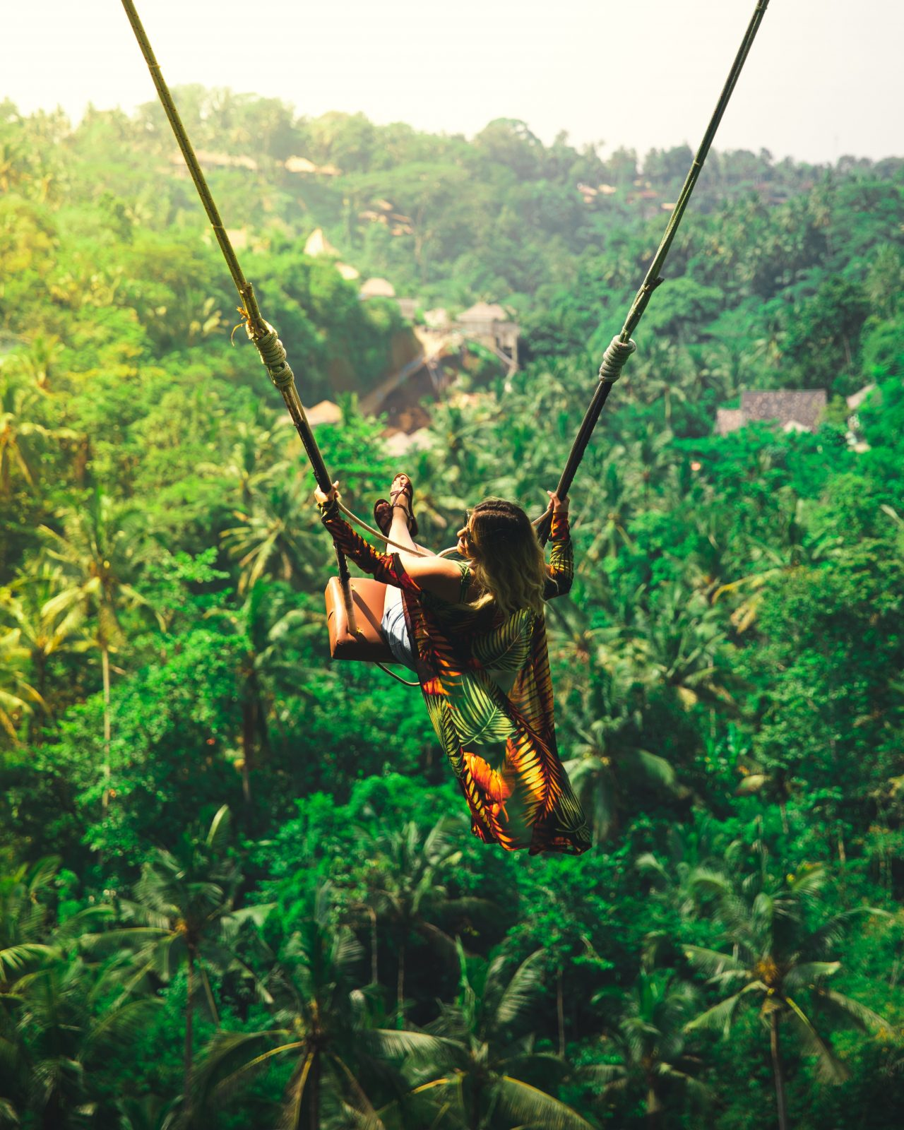 Woman on famous Ubud swing in Bali