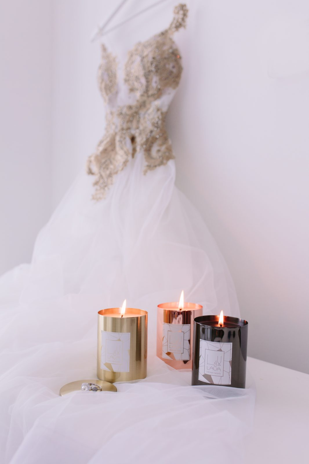Lava Candles next to wedding dress