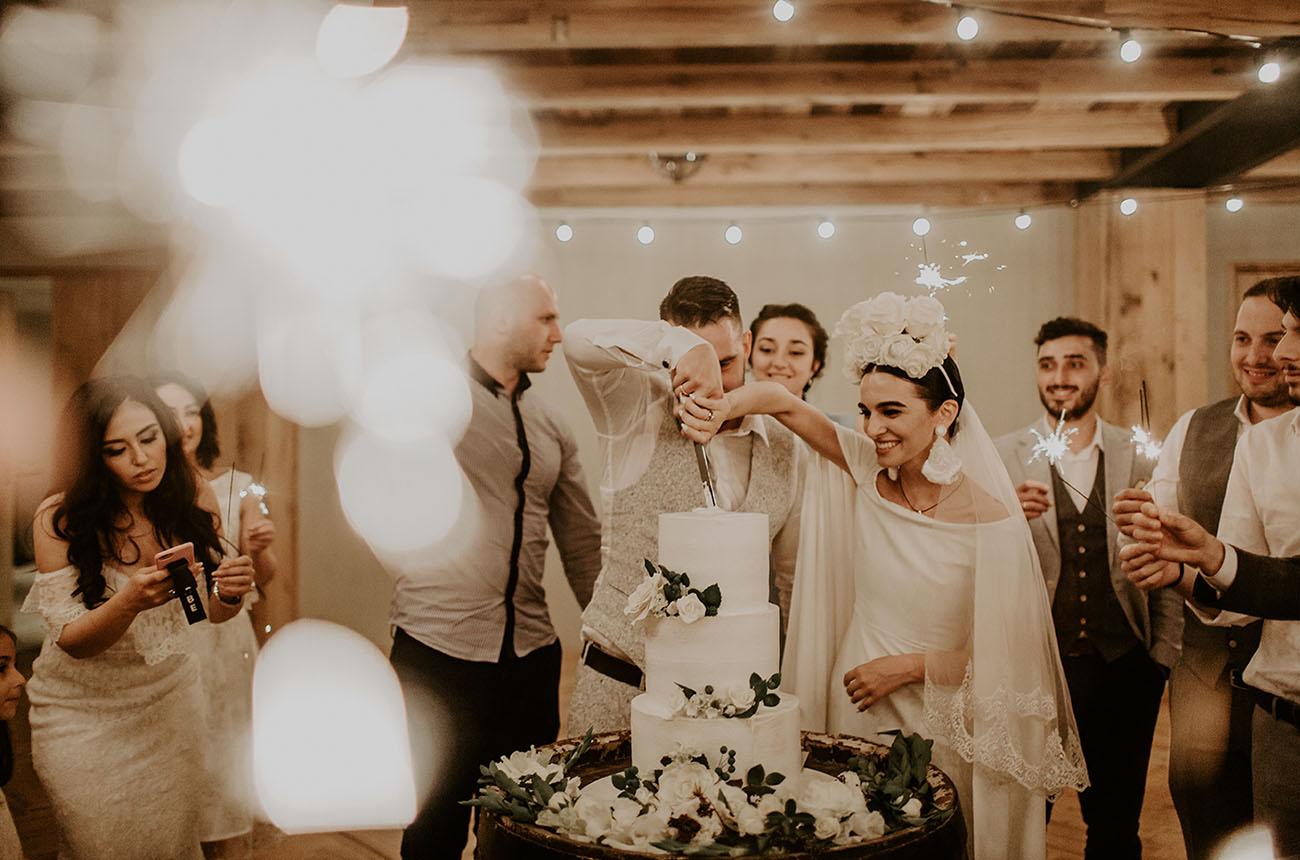 Khatia and Andrew cutting wedding cake