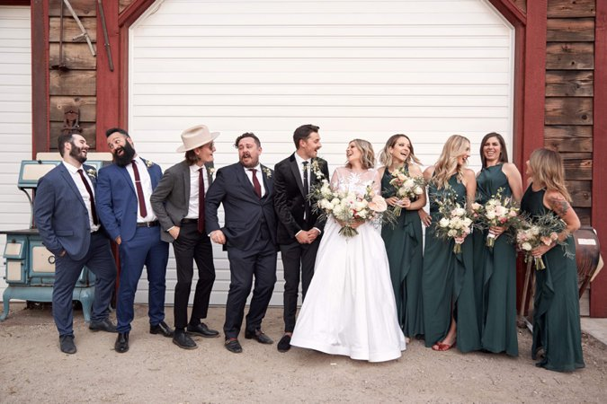 Bride and Groom posing with Groomsmen and Bridesmaids