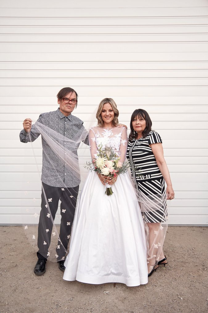 Bride posing with Mother and Father