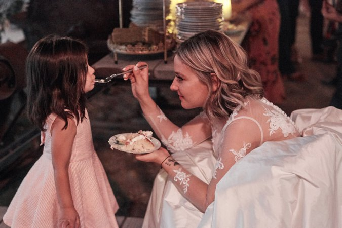 Bride feeding small wedding guest