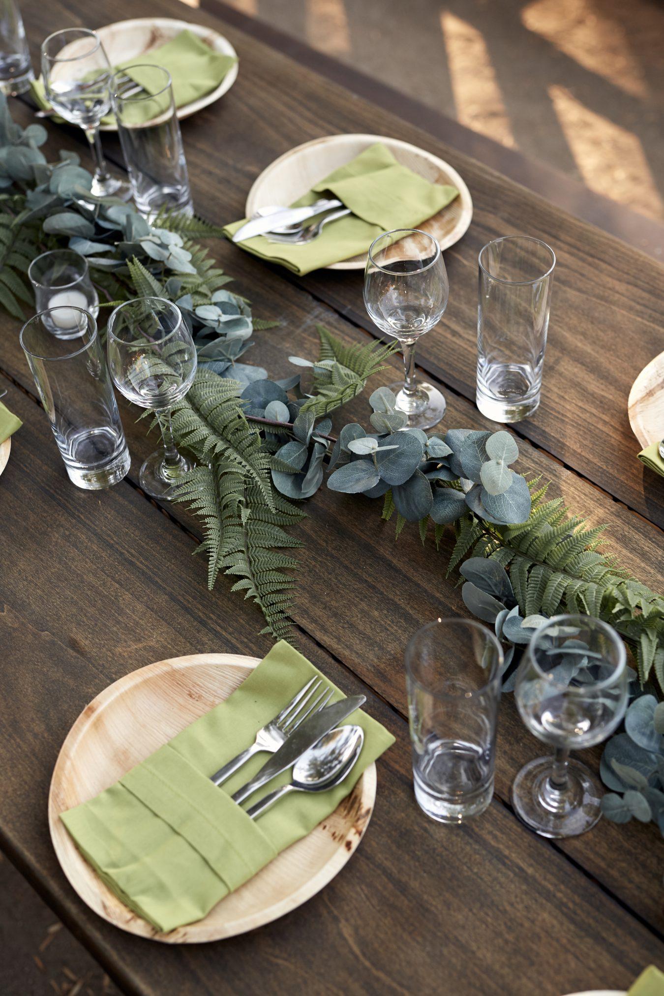Green table decor at wedding
