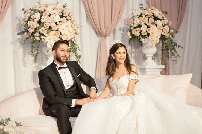 Arabic Bride & Groom on wedding sofa