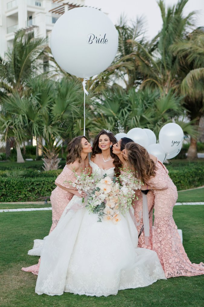 Bride with BRIDE Balloon and Bridesmaids