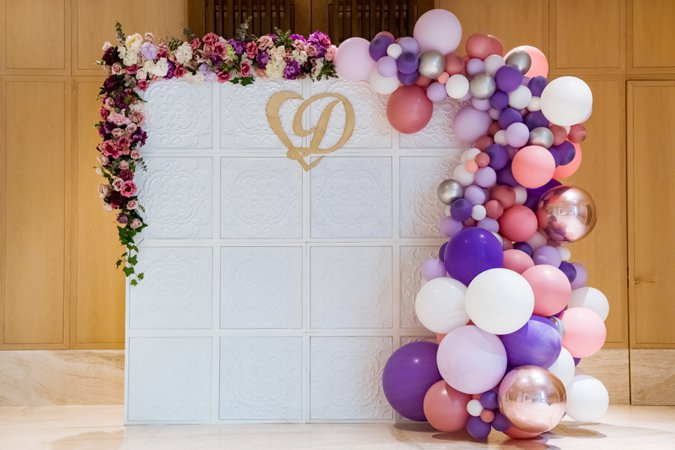 Wedding flower wall with balloons