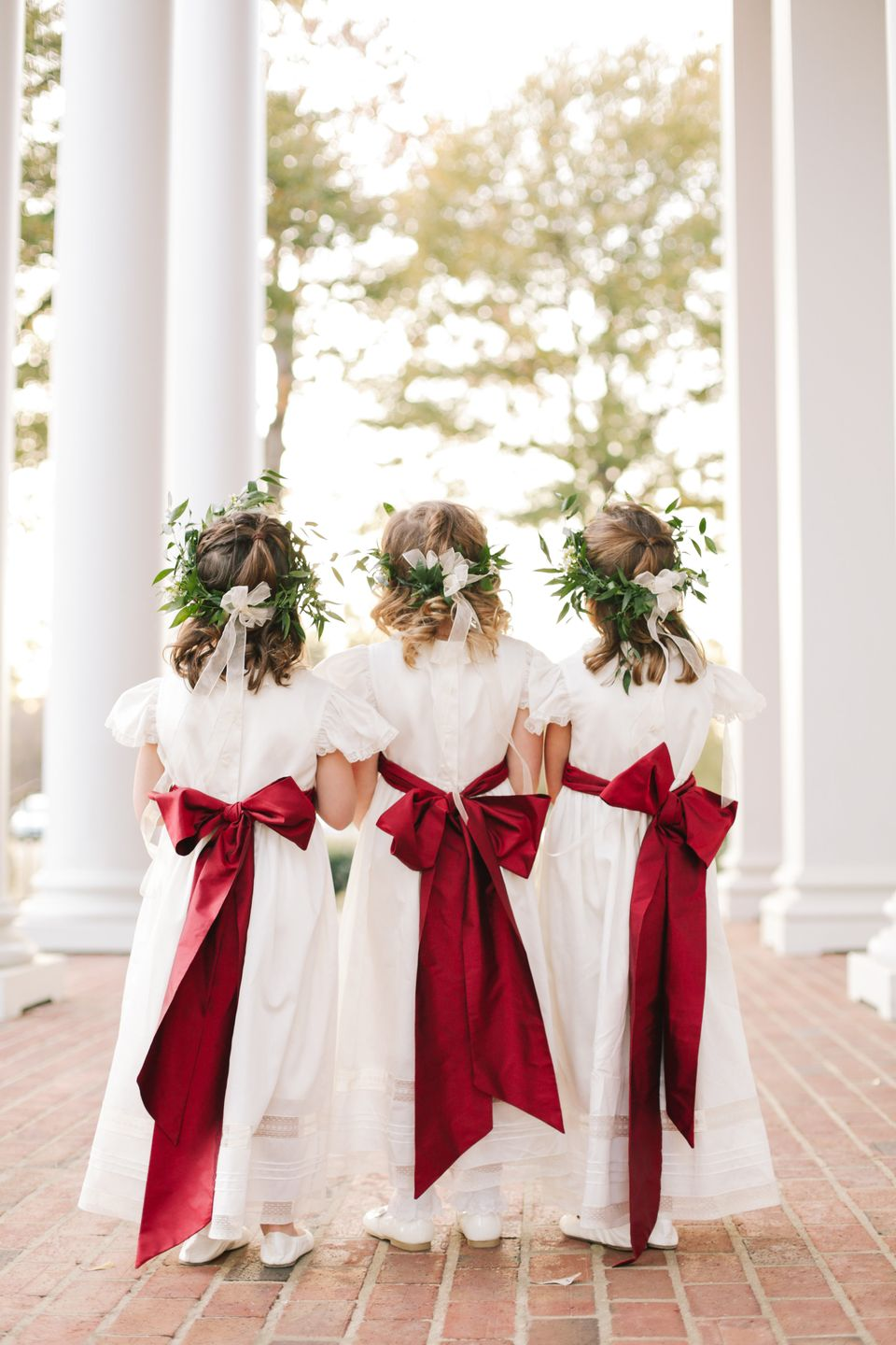 Flower girls with red bows
