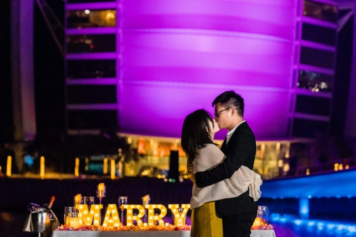 Chinese couple proposal on the beach in front of the Burj Al Arab - Photography by Chandan Sojitra