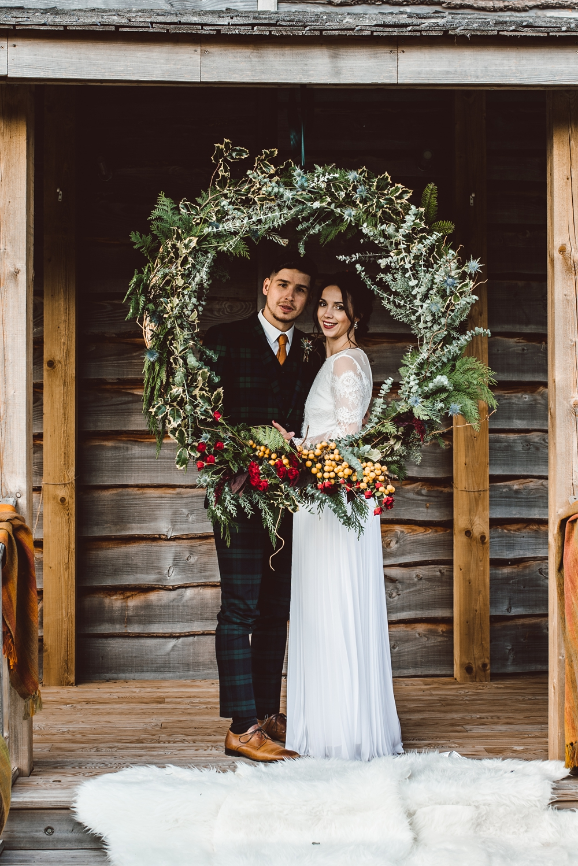 Bride & Groom with festive wreath