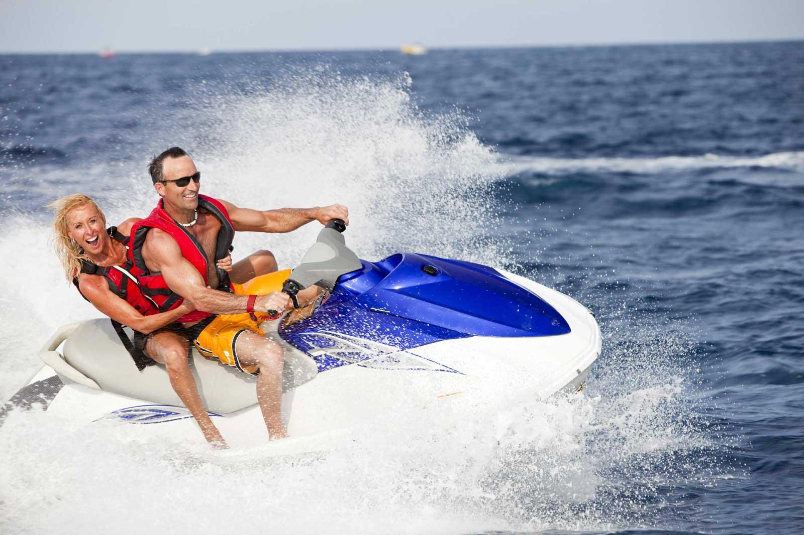 Couple having fun on a jet ski
