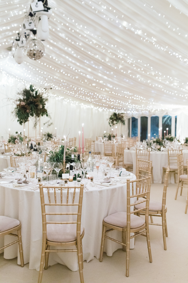 Beautiful white wedding marque with fairy lights