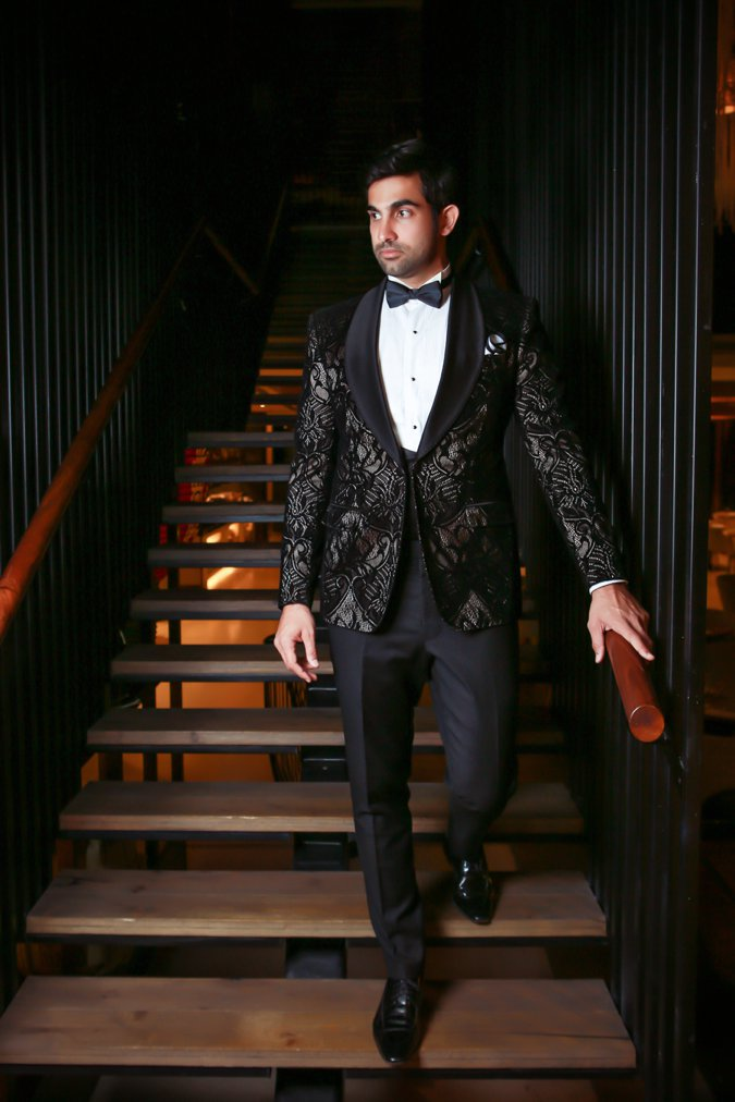 Man in silver and black black tie suit