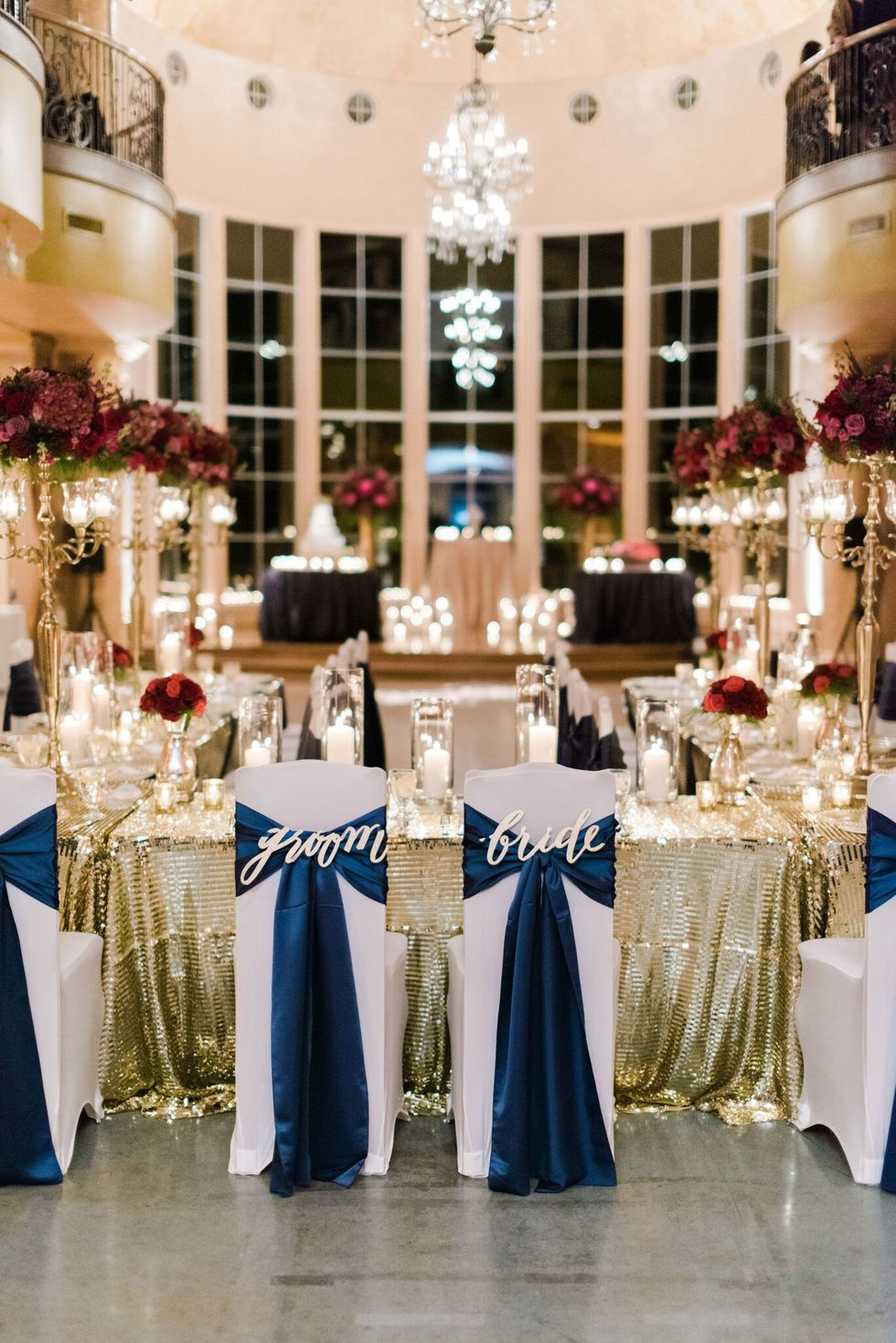 Blue sashes on Bride & Groom chairs at wedding