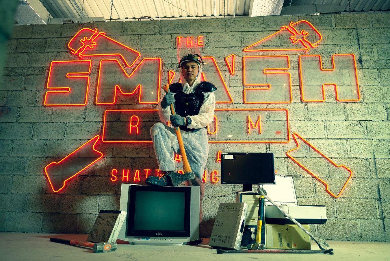 Man posing with axe at The Smash Room Dubai