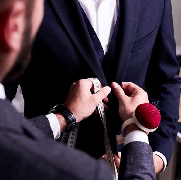 Man tailoring a man's suit