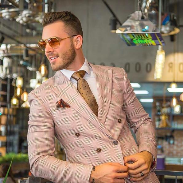 Man in pink tweed suit